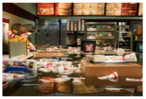 Image of flooded McDonalds by art collective Superflex